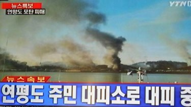 This frame grab taken off South Korean broadcaster YTN shows plumes of smoke rising from Yeonpyeong island in the disputed waters of the Yellow Sea.