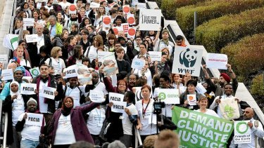 Members of NGOs walk out of the UN Climate Change Conference in Warsaw, claiming the talks are 'on track to deliver virtually nothing.'