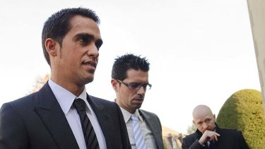 Three-time Tour de France champion Alberto Contador (L) arrives flanked by his brother Fran (C) and his laywer Mike Morgan at his hearing at the Court of Arbitration for Sports in Lausanne.