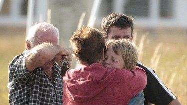 Friends and family members at the scene of the fatal hot air balloon crash in Carterton, New Zealand.