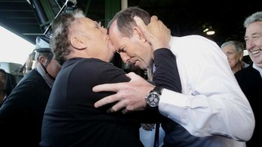 Tony Abbott greeted by Nino Barbaro.
