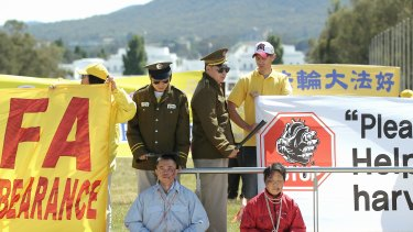 Falun Dafa protesters out the front of Parliament House for the visit by Chinese President Xi Jinping.