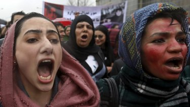 Afghans at a protest in Kabul on Tuesday to condemn the killing of 27-year-old woman, Farkhunda, who was beaten with sticks and set on fire by a crowd of men in central Kabul.