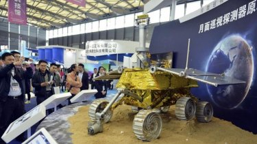Public appeal: Visitors at a trade fair take pictures of a prototype model of a lunar rover in Shanghai in November.
