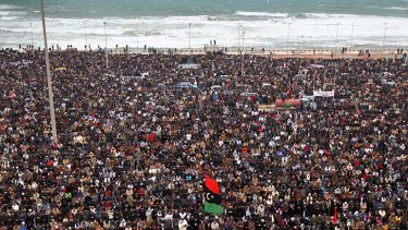 Mass appeal ... Libyans pray while demonstrating for the removal of Muammar Gaddafi in Benghazi.