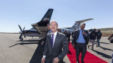 Queensland Premier Campbell Newman being welcomed by members of the Wagner family