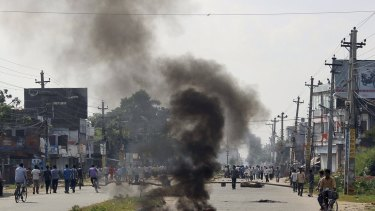 Smoke from burning tyres in the town of Birgunj on the border with India.