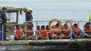 Asylum seekers arrive on Christmas Island after Indonesia refused to allow them to return.