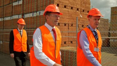 Then opposition leader Tony Abbott at the Austral Brickworks to discuss carbon tax issues with workers.