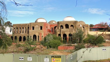 The Oswals ploughed millions into their expansive residence in Perth's ritzy suburb Peppermint Grove.