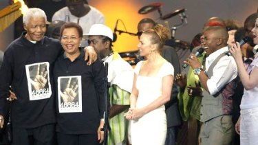 Former South African president Nelson Mandela with his wife Graca Machel attends the 46664 concert in honour of his 90th birthday in London.