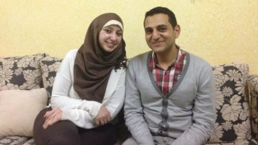 """Sameeha Elwan, with her husband Ayman Qwaider.   """"Since I was awarded the PhD scholarship, every day [was] a reminder that to be a Palestinian is to be entrapped in a circle of waiting,"""" she wrote."""
