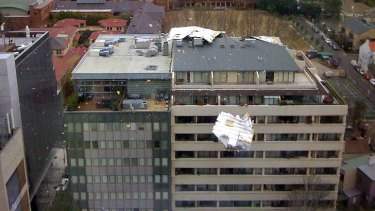 A roof blows off a building in North Sydney.