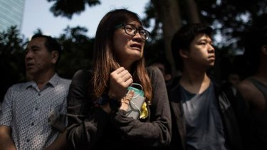 A pro-democracy protester reacts while watching police remove barricades on Queensway in the city's Admiralty district on Tuesday.