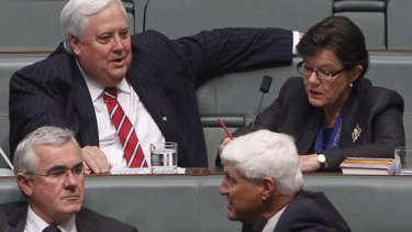 Palmer United Party MP Clive Palmer takes his seat in Parliament next to Indi indpendent Cathy McGowan with Andrew Wilkie (Tasmania) and Bob Katter (Queensland).
