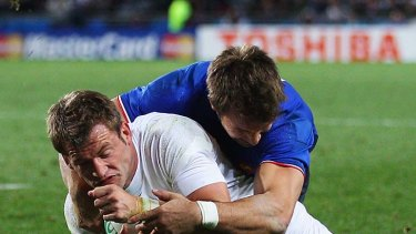 Mark Cueto of England goes over to score a try.