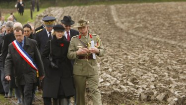 Ms Bryce is escorted to the recently rediscovered burial site of unknown Australian and British soldiers at Fromelles.