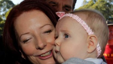 The baby kissing began for Prime Minister Julia Gillard on the first day of campaigning.