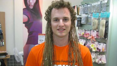 Andrew McMillen enjoys his last moments with his dreadlocks.