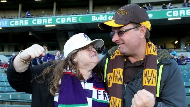 Mock rage: A Fremantle fan and Hawthorn fan face off before Friday night's match.