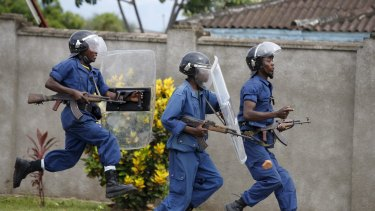Policemen clash with protesters near a parliament building during a protest against President Pierre Nkurunziza.