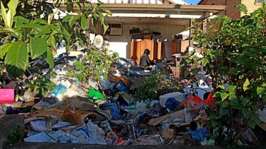 Clean-up operation: It is estiimated that it will take five days to clear out the house.