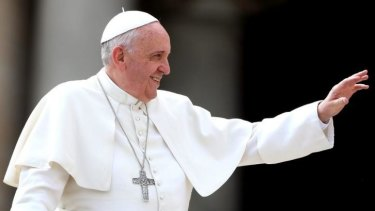 Not a film buff: Pope Francis waves to the faithful as he holds his weekly audience in St Peter's Square.