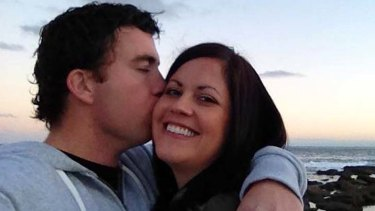 Kate Malonyay smiles while Elliott Coulson kisses her.