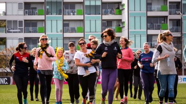 Women and girls at the footy clinic at Arden Street Oval.