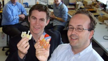 Dr John Fraser and Dr Daniel Timms, lead biomedical engineer for BiVacor, holding a model of the pump device and a model of the human heart for comparison.