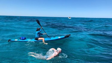 Eli Ball was the first swimmer to spot the suspected great white shark as it swam underneath his support boat.