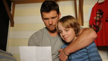 Great news: Sam Worthington and Ed Oxenbould.