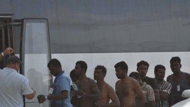 Asylum seekers arrive on Christmas Island yesterday.