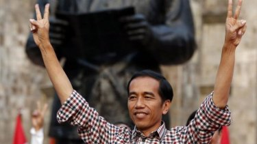 Indonesian presidential candidate Joko Widodo declared victory on Wednesday in front of a statue of Indonesia's founding father, Sukarno.