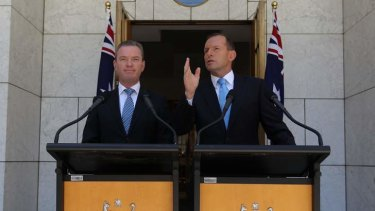 Education Minister Christopher Pyne and Prime Minister Tony Abbott address the media at Parliament House.