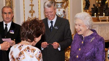 We are very amused ... the Queen reacts to Kathy Lette's corgi chic.