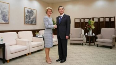 On friendlier terms: Australia's Foreign Minister Julie Bishop and her Chinese counterpart Wang Yi in Sanya, Hainan Province.