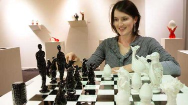Crystal Stubbs with a chess board from her exhibition.