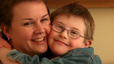 Future fears: Catherine McAlpine with one of her three sons, Julian, who has Down syndrome.