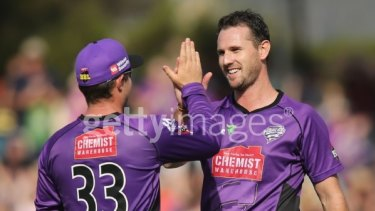 High five: Shaun Tait celebrates a wicket with Hurricanes teammate Michael Hill during the Big Bash League match against the Perth Scorchers.