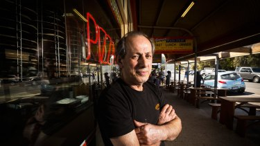 Business down 35 per cent: George's Take Away owner George Papadopoulos outside his store in Apollo Bay.
