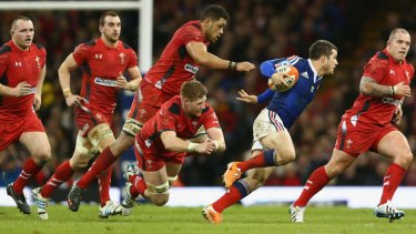 Nowhere to hide: Brice Dulin of France evades the Welsh defence.