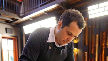 Currying favour ... MasterChef series two's Jimmy Seervai in the kitchen.