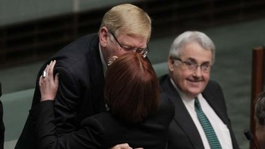 Prime Minister Julia Gillard embraces former minister Martin Ferguson on Wednesday.