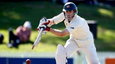 Toughing it out  . . . Simon Katich has batted Australia into a strong position.