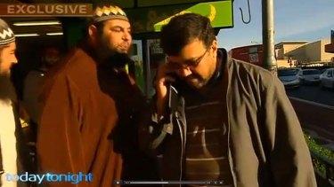 Omar Ammouche spits on Jamal Daoud.