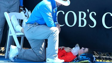 "Heat takes its toll on a ballboy at the Australian Open: officials invoked the tennis tournament's ""extreme heat policy""."