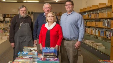 Clouston and Hall booksellers owners Tom, Sally and Jack Clouston with manager Rod Howell, left.