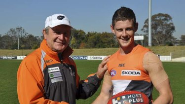 Finally there … coach Kevin Sheedy congratulates Sam Darley on his call-up against Brisbane this weekend.