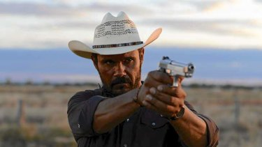 Detective Jay Swan (Aaron Pedersen), returns to his home town to find it has been taken over by the lawless, in <i>Mystery Road</i>.